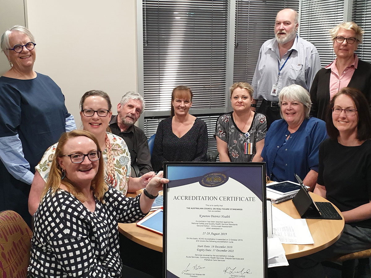Photo of team with ACHS certificate